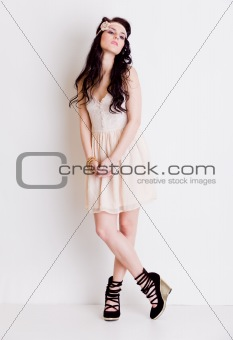 Full length fashion girl posing in studio