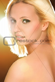 Portrait of pretty blond hair woman in flash lights. Retouched