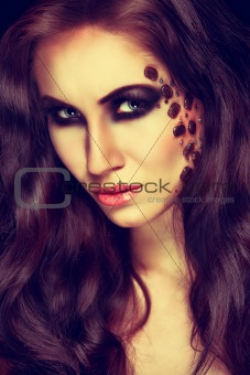 Portrait of mysterious woman with extravagant makeup. Retouched