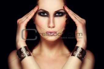 Portrait of mystic woman with extravagant makeup. Retouched