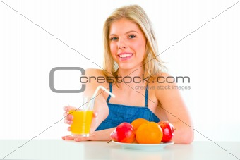 Smiling beautiful girl giving orange juice
