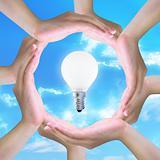 light bulb in women hand making a circle