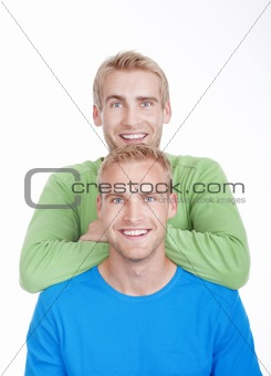 portrait of young twin brothers with blond hair and blue eyes - isolated on white
