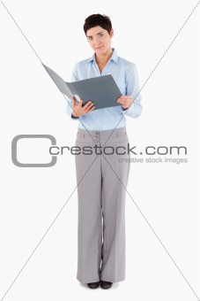 Businesswoman holding a binder