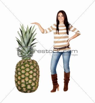 Beautiful brunette girl with a big pineapple