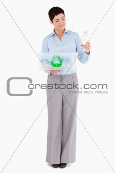 Woman with a plastic bottle and a recycling box