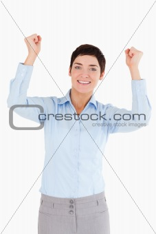 Portrait of a cheerful businesswoman with the fists up
