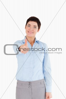 Portrait of a businesswoman with her thumb up