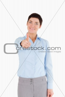 Portrait of a businesswoman with the thumb up