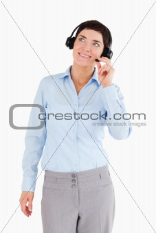 Portrait of a smiling office worker with a headset