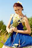 Summer meadow. beautiful woman with bunch of chamomiles