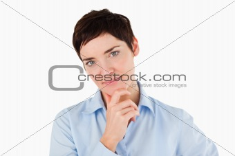 Close up of a businesswoman with her hand on her chin
