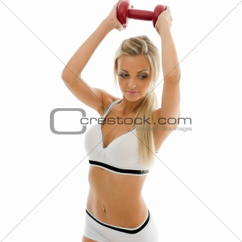 beautiful woman is making exercises with dumbbells