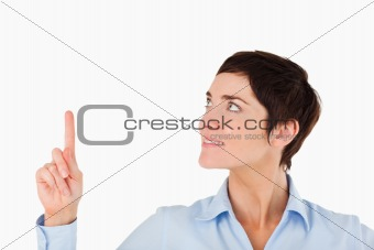 Close up of a businesswoman pointing at copy space