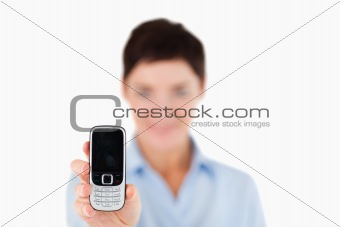Close up of a woman showing a cellphone