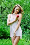 beautiful woman with apple in the forest