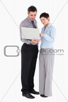 Office workers using a laptop