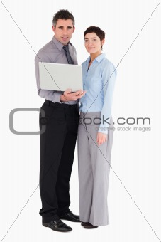 Office workers holding a laptop