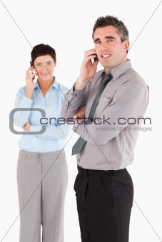 Portrait of coworkers making a phone call