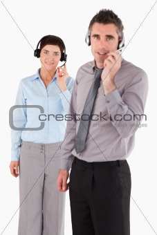 Portrait of coworkers using headsets