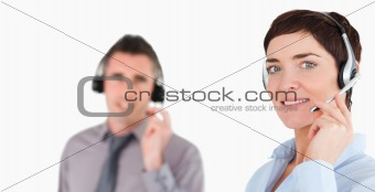 Close up of office workers using headsets