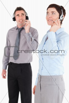 Portrait of colleagues using headsets