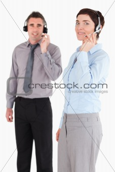 Portrait of managers speaking through headsets