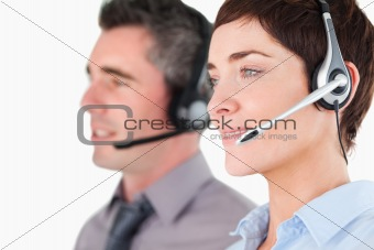Close up of operators using headsets
