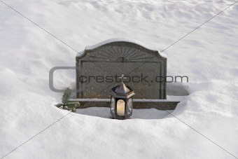 tombstone in snow
