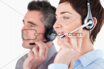 Close up of operators speaking through headsets