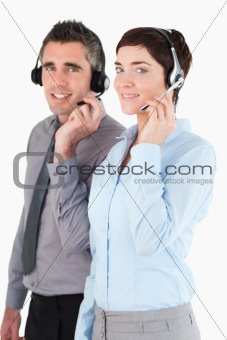 Portrait of operators speaking through headsets