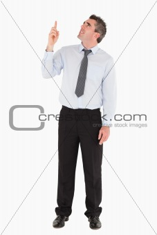 Man pointing at copy space