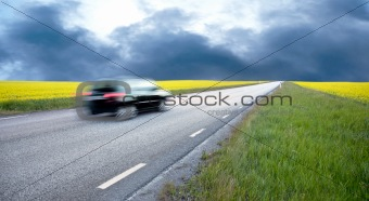 Blurred car in rape field