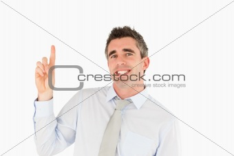 Smiling businessman pointing at copy space