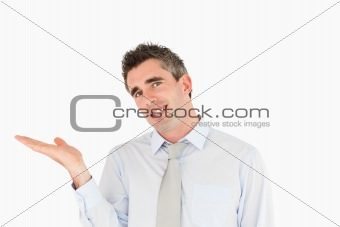 Smiling businessman showing a copy space