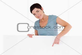 Woman pointing at something on a panel