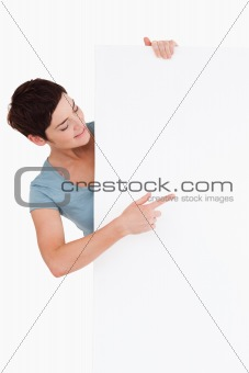 Smiling brunette looking at a blank panel