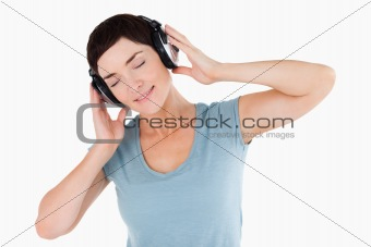 Close up of a woman enjoying some music