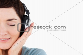 Close up of a delighted woman enjoying some music