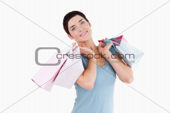 Cute woman posing with shopping bags
