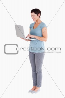 Cute woman using a laptop