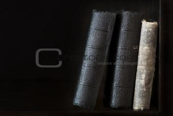 Old books in bookshelf