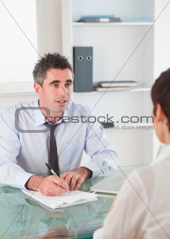 Portrait of a manager interviewing an applicant