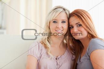 Charming women sitting on a sofa