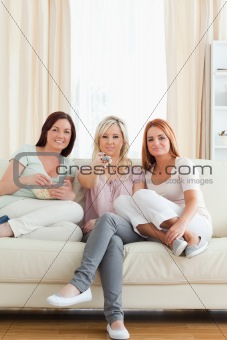 Cute Women watching a movie eating popcorn