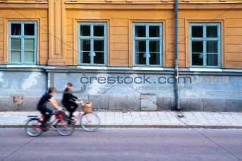 Two persons on bicycles