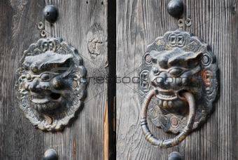 Bronze lion's head handles