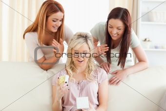 Charming women giving their friend a present