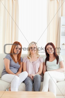 Cute women lounging on a sofa