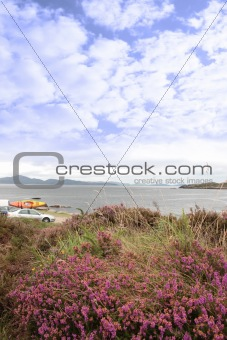 car and kayak with scenic view